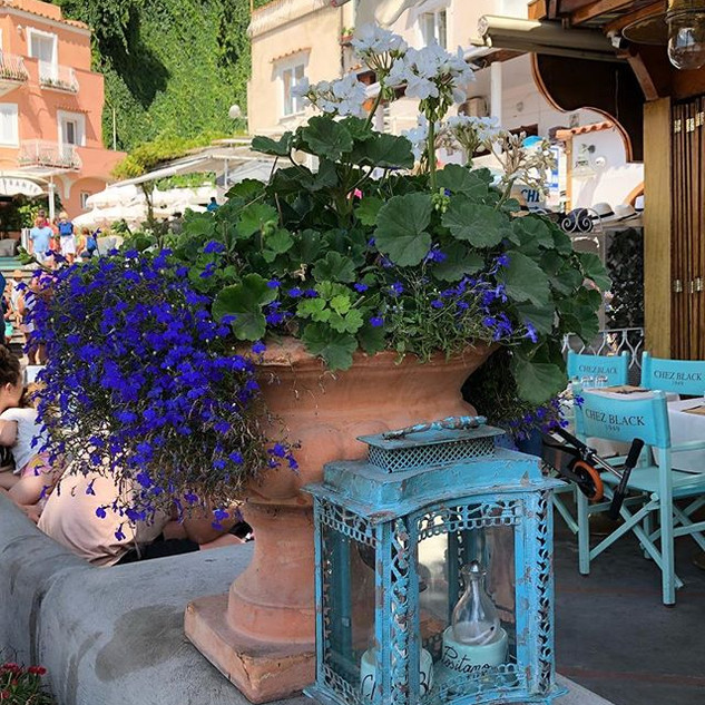 Loved this flower pot of blue outside Ch