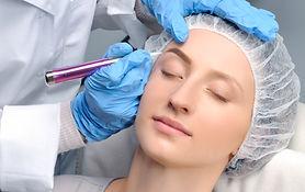 Microblading eyebrows. Cosmetologist mak