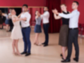 Young positive people dancing together s