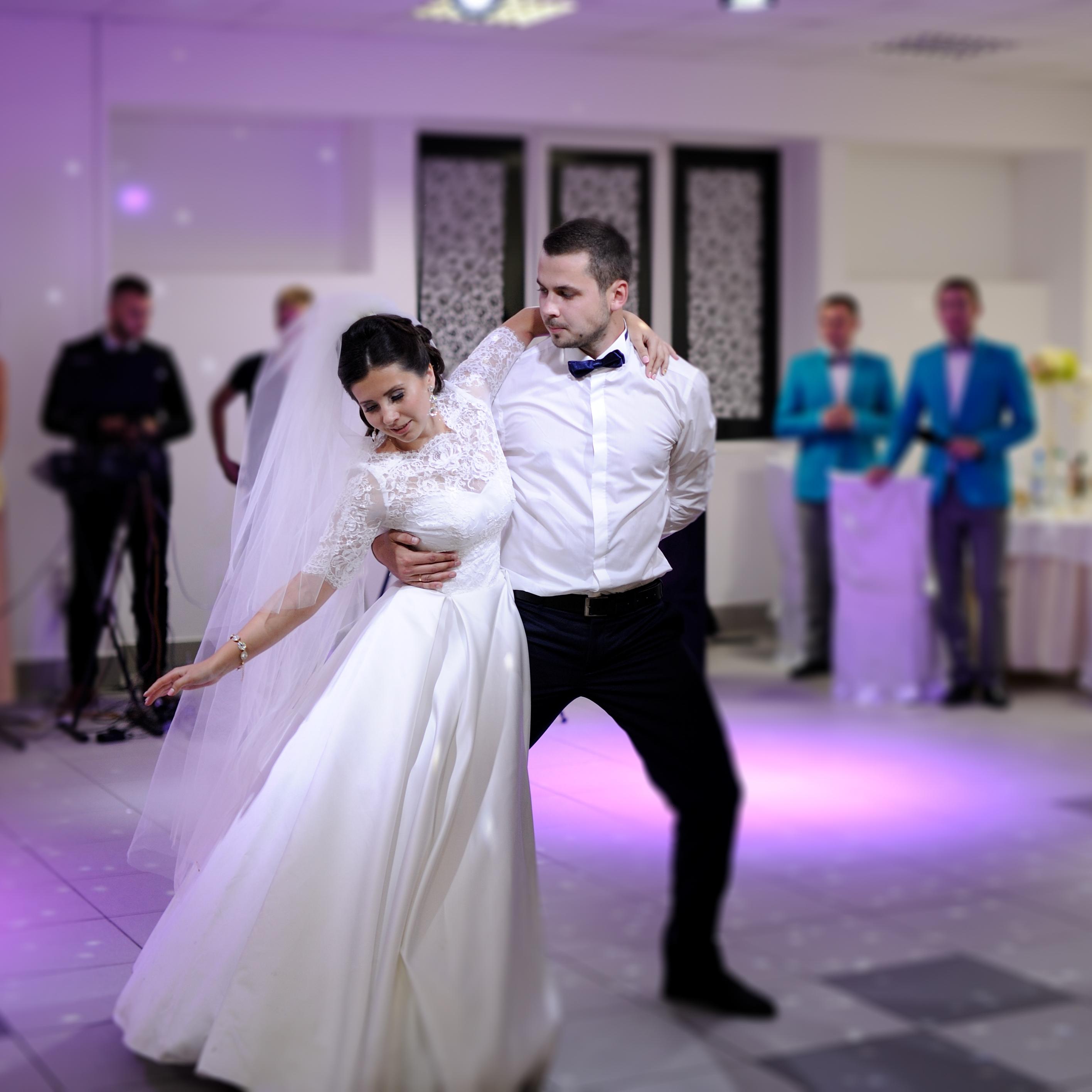 bride and groom dancing on the own weddi