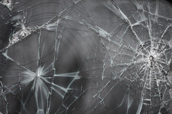 cracked_glass_texture_ii_by_everythingisinstock.jpg