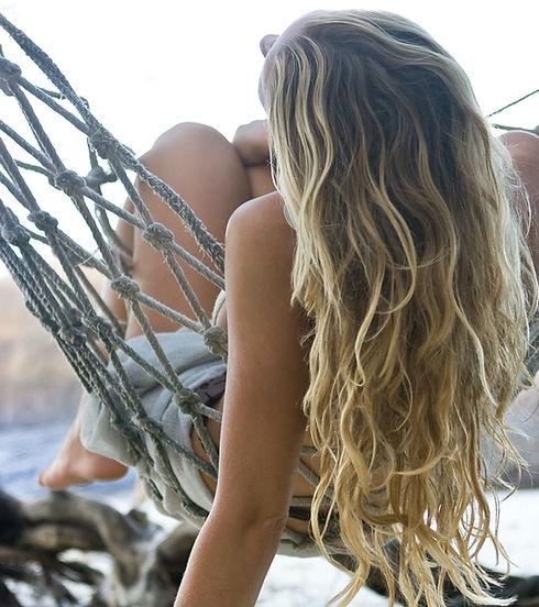 Blond%20girl%20lying%20in%20hammock%20on
