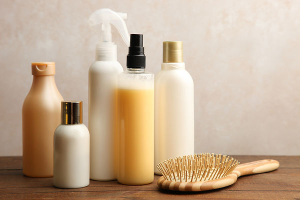 Hair care products on a wooden table on