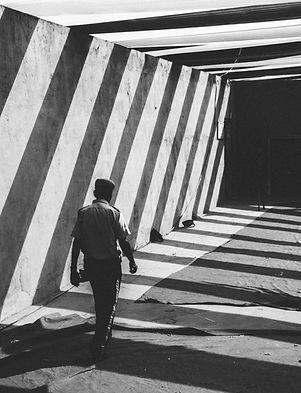 Man Walking Through Passage