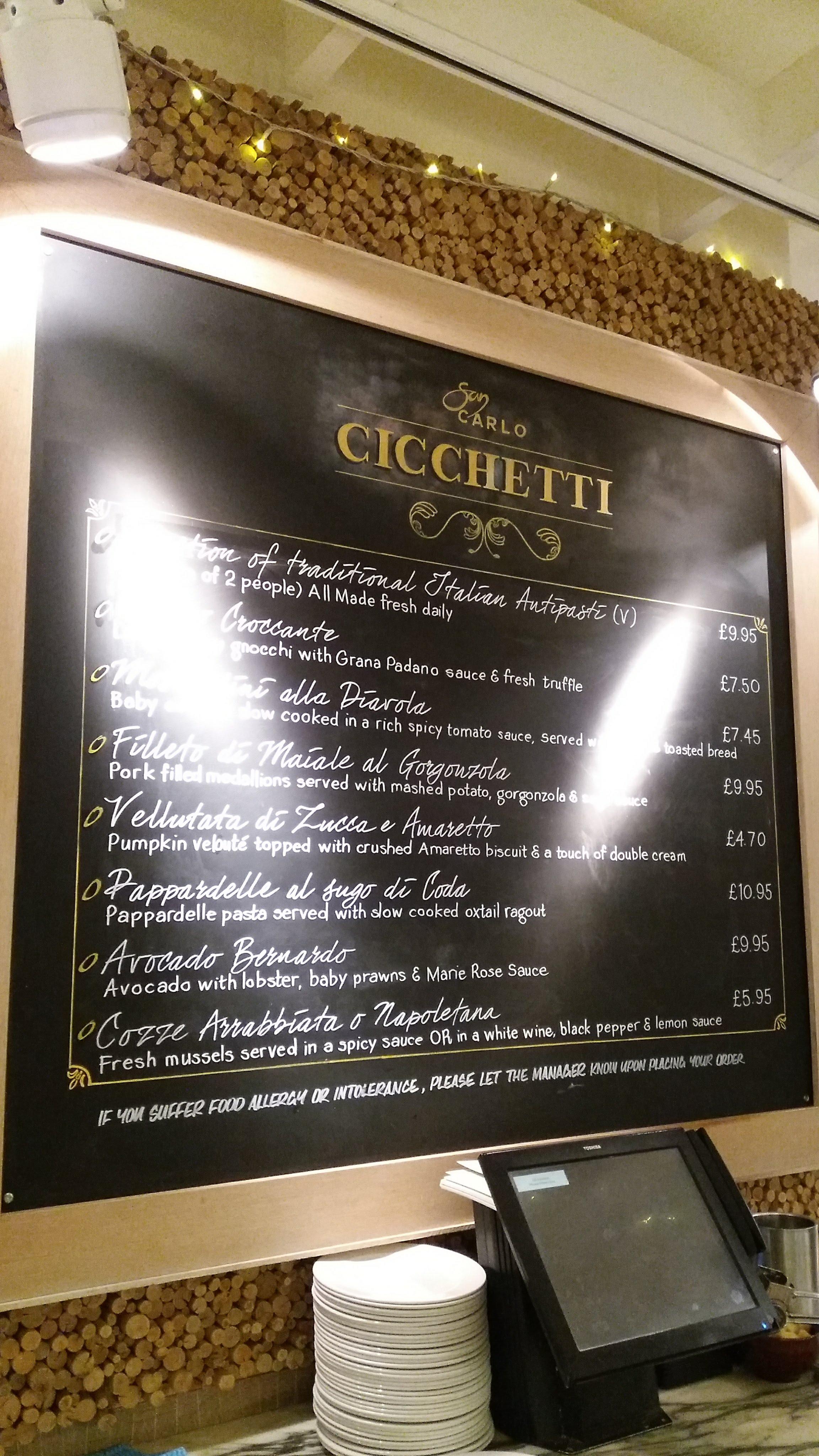San Carlo Cicchetti , Manchester