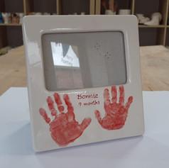 Handprints on frame.jpg
