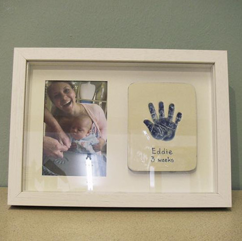 Baby Hand and Photo Framed
