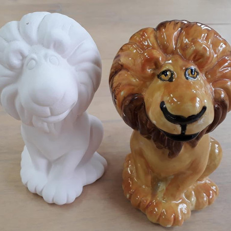 Ceramic lions before and after