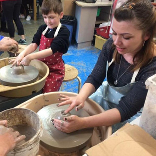 Child and Parent Potters Wheel.jpg