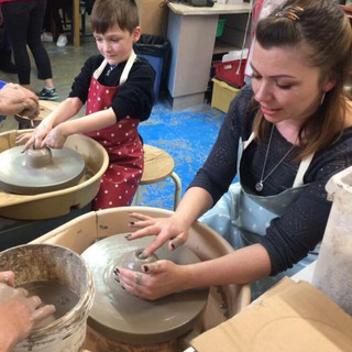 Child and Parent Potters Wheel