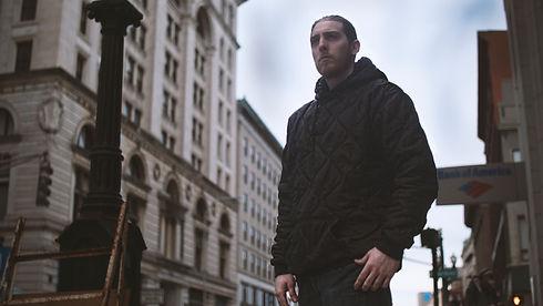 black hoodie city.jpg