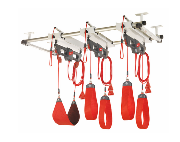 """The Redcord's patented """"bungee assistance"""" system fully supports the patient through each movement to prevent pain and compensation. You adjust the ropes and bungee cords to maintain proper form and control the assistance, resistance and neuromuscular challenge."""