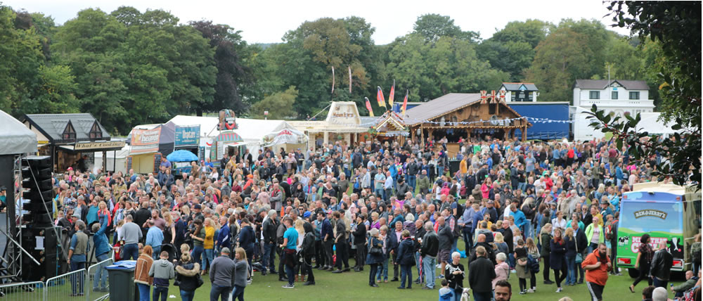 Crowds watch the free music while sampling food and drink nearby
