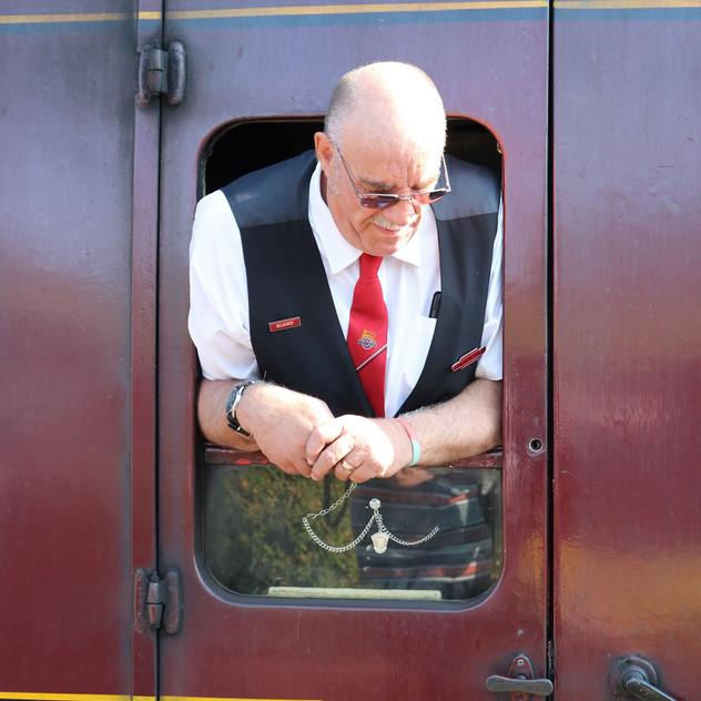 Train guard looking out of window.jpg