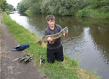 Boy with pike by canal