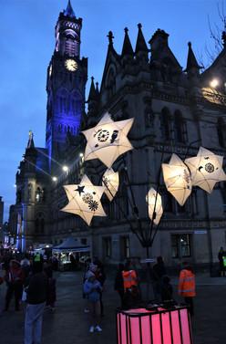 Illuminated bird lantern outside city hall