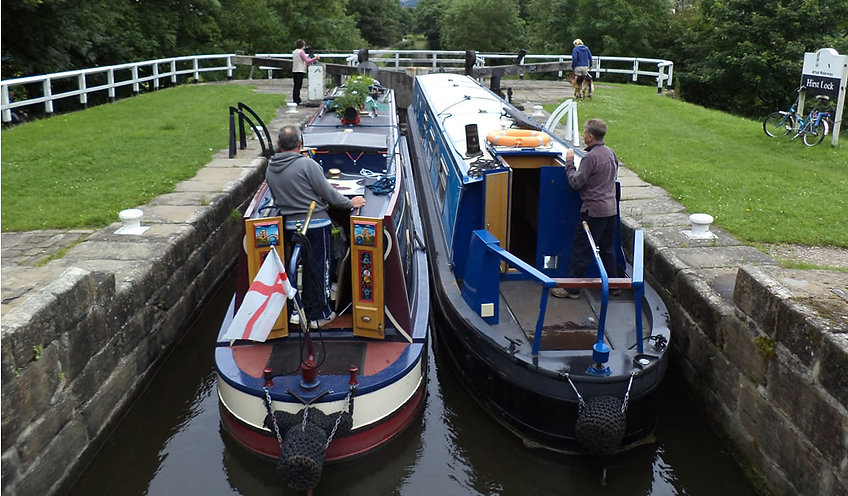 Two canal boats in lock