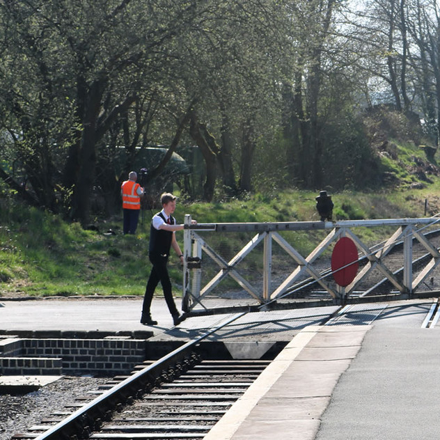 Closing gates at Oakworth level crossing