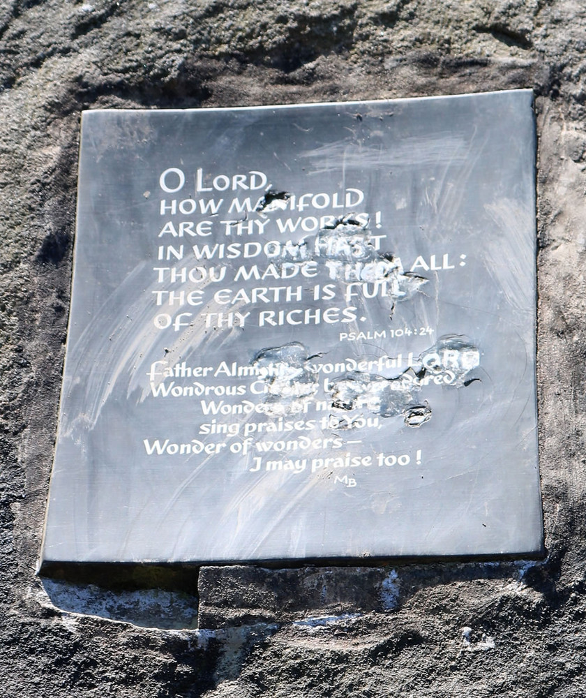Lord plaque set into stone