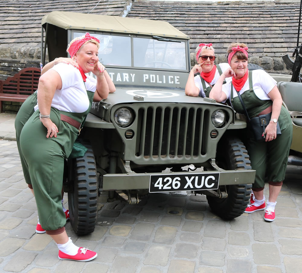 Land girls lean on Military Jeep