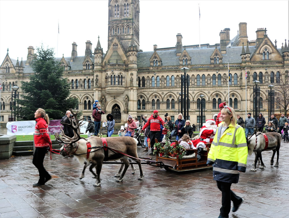Santa Claus passes City Hall Bradford 2019