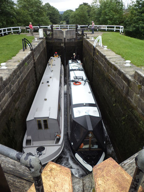 Two canal boats in Hirst Lock