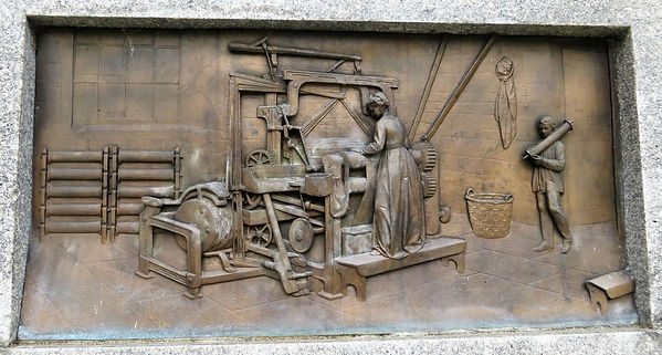 Woman operating a tappet loom; Bronze plaque