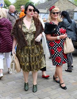 Two women dress in period costume Haworth 1940s
