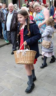 Young girl evacuee with basket Haworth 1940s