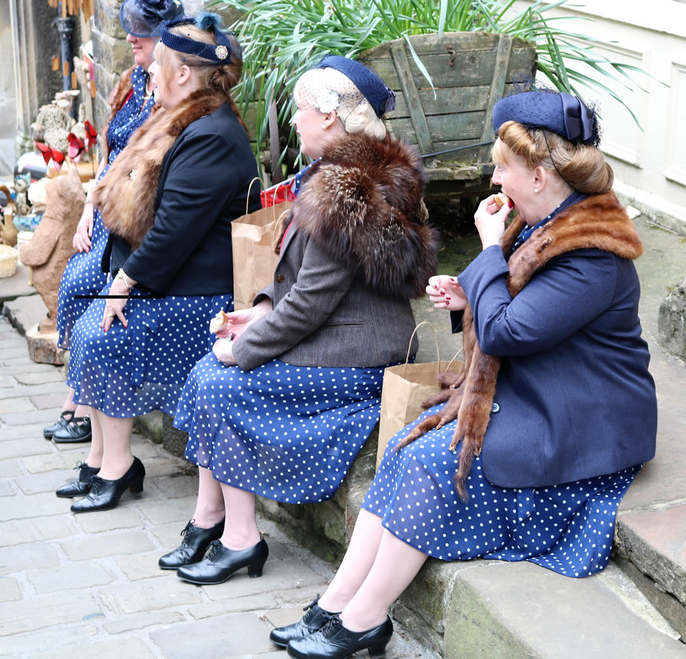 Four women in period dress enjoying the annual Haworth 1940s weekend