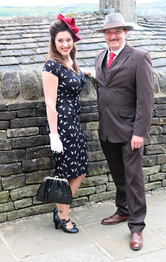 Couple against wall in period costume Haworth 1940s