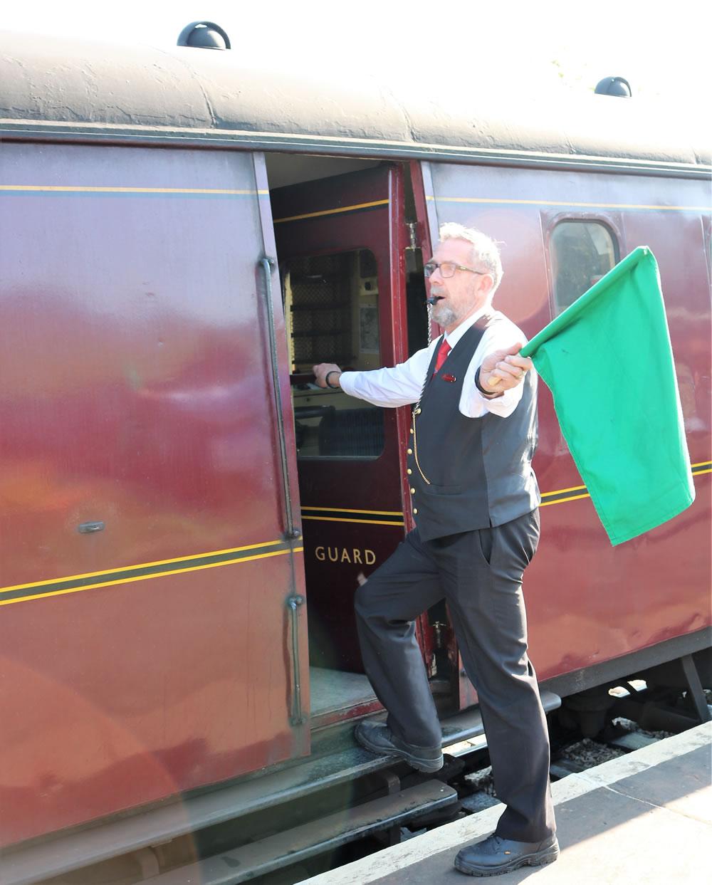 Guard send off the train Green Flag