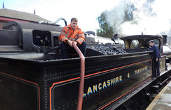 Steam locomotive takes on water