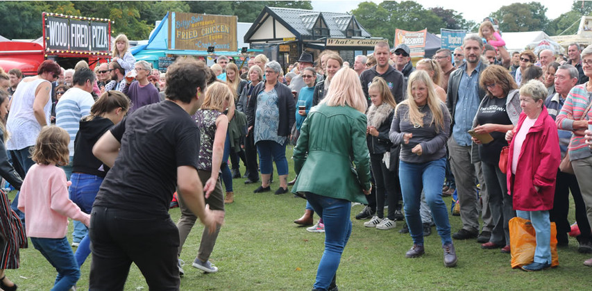 Dancing in park Saltaire festival