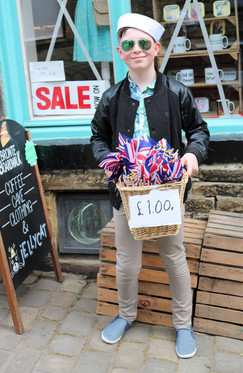 Young boy sells flags Haworth 1940s