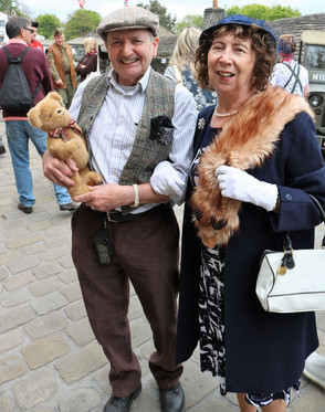 Couple in period costume & teddy Haworth 1940s
