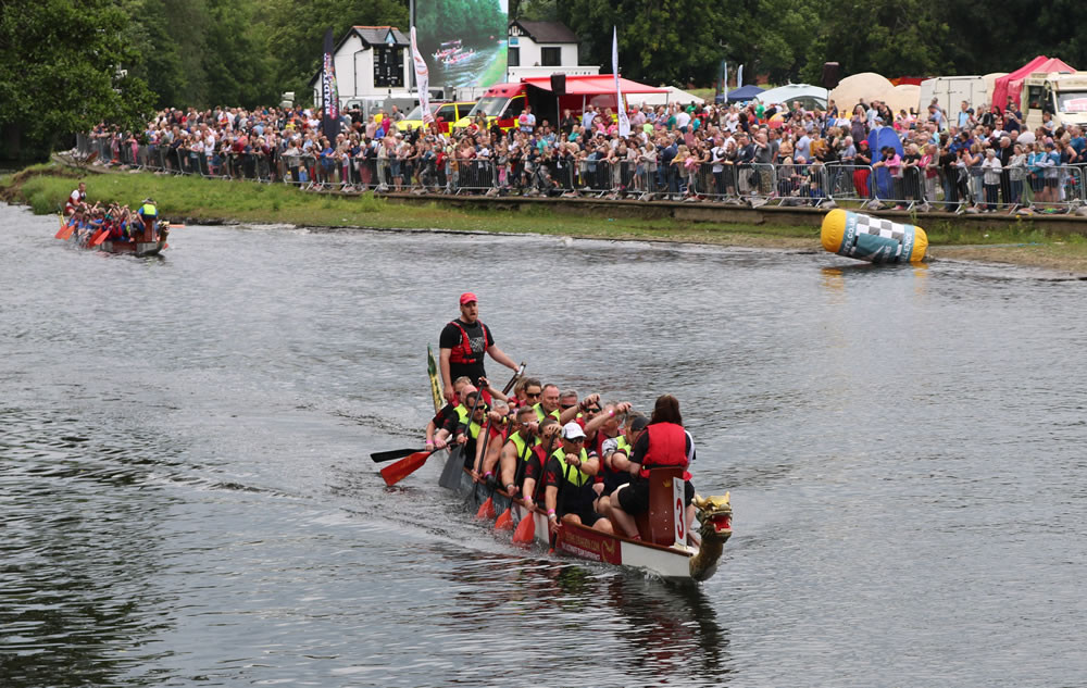 Dragon Boat racing involves teams of up to twenty paddlers in a 40-foot boat with a drummer at the helm, paddling frantically to beat the other teams down the course. The drums, shouting and colourful boats all make it an impressive and exciting sport both to watch and to compete in.