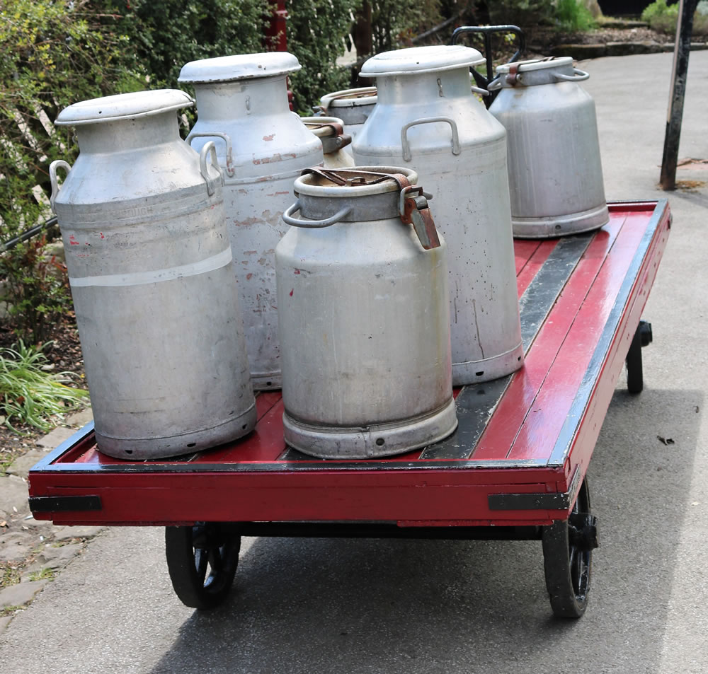 Milk churns on cart at Oxenhope station.