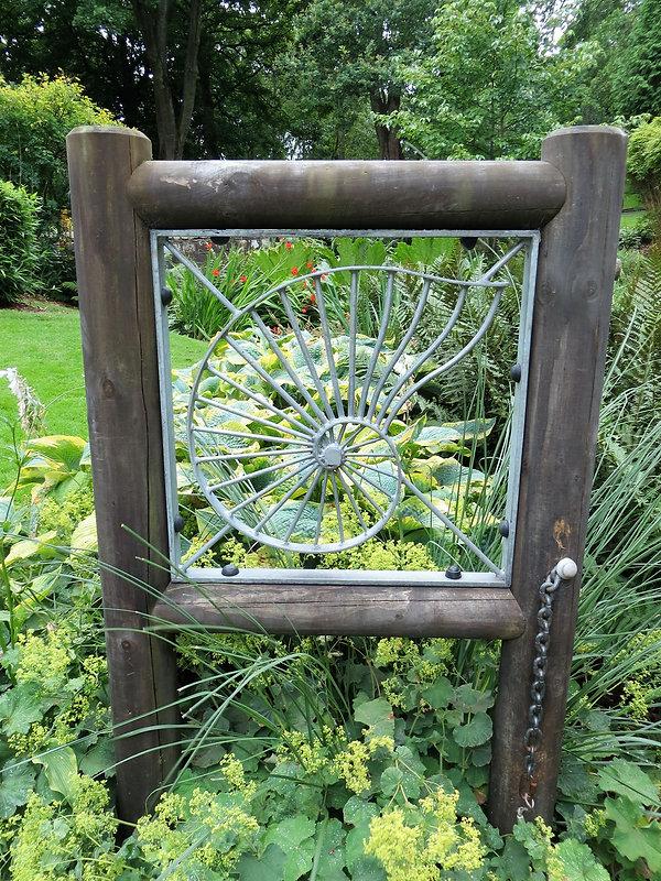 Shell ironwork in wooden frame