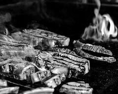 half-grilled-half-ready-raw-steaks-on-the-grill_edited.jpg