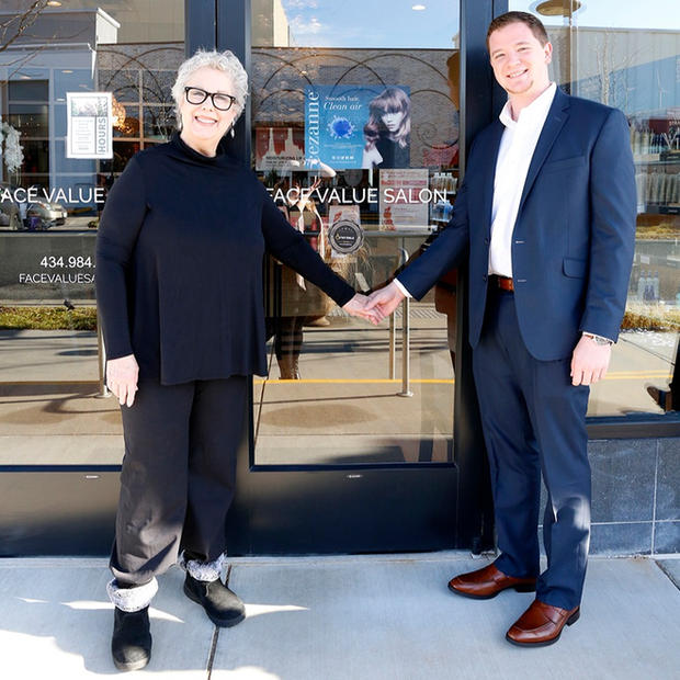 The owner of Face Value Salon standing with Joe Jamison in front of her store. - Photo by Eichner Studios