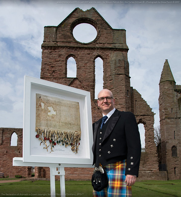 Steven Patrick Sim with the Declaration of Arbroath 3D replica ...a limited edition fine art facsimile reproduced with permission kindly granted by the National Records of Scotland, 2016. Image taken by Drew Porch, at the official photo-shoot, 3rd April 2017 …in the grounds of the Arbroath Abbey.