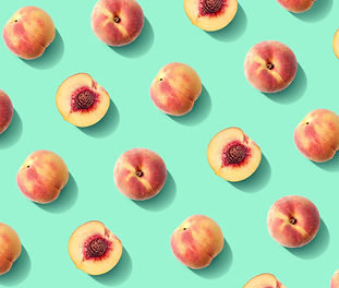 Colorful fruit pattern of fresh peaches