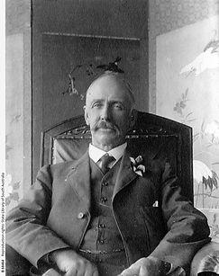 Studio portrait of Edmund Bowman seated in his living room. B-68464.jpeg