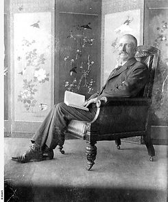 Studio portrait of Edmund Bowman seated in his living room. B-68465.jpeg
