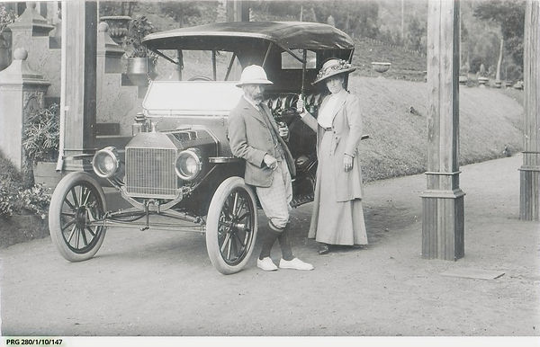 An early model Ford motor car and owners