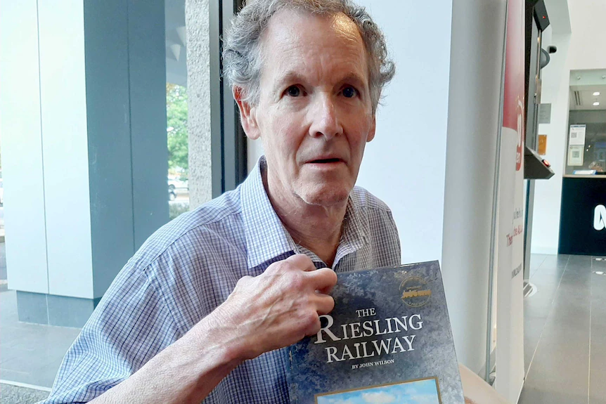 Dr John Wilson holds his book 'The Riesling Railway'