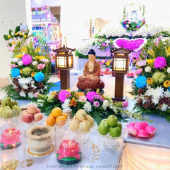 Buddhist Setup With Standing Lamps and Personalised Flowers