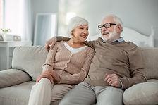 Elderly couple. Joyful aged man hugging