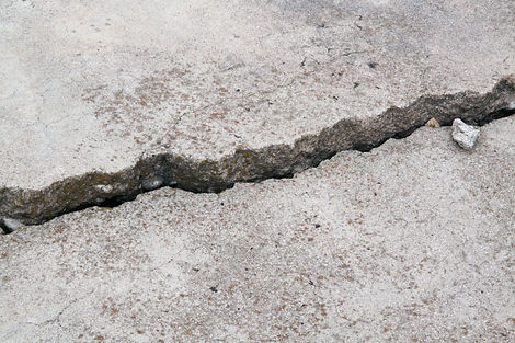 cracked concrete cement sidewalk foundat